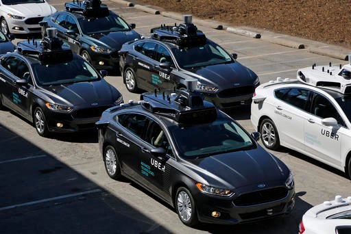 A group of self driving Uber vehicles position themselves to take journalists on rides during a media preview at Uber's Advanced Technologies Center in Pittsburgh.