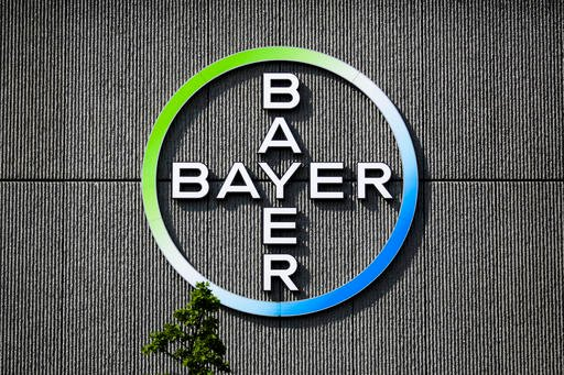 Bayer AG corporate logo is displayed on a building of the German drug and chemicals company in Berlin, Germany.
