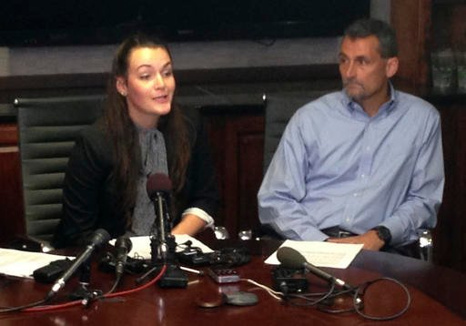 Delaney Robinson speaks while her father, Stacey Robinson, listens at a news conference Tuesday, Sept. 13, 2016, in Raleigh, N.C. A magistrate issued an arrest warrant Tuesday for a North Carolina football player accused of sexual battery and assault on R