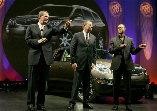 FILE - This Nov. 26, 2006, file photo shows Rick Wagoner, Chairman and CEO of General Motors, left, Buick General Manager Steve Shannon, center, and PGA golfer Tiger Woods introducing the 2008 Buick Enclave in Pasadena, Calif.