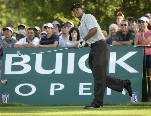 FILE - This is a July 31, 2003, file photo showing Tiger Woods watching his tee shot on 14 during the first round of the Buick Open at Warwick Hills Golf and Country Club in Grand Blanc, Mich.