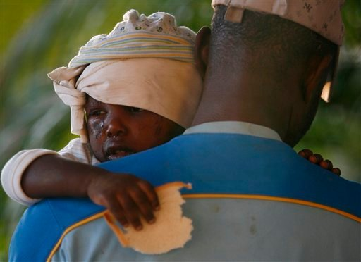 A young injured earthquake survivor holds a piece of bread in a makeshift shelter in Port-au-Prince, Haiti, Thursday, Jan. 14, 2010. A 7.0-magnitude earthquake struck Haiti Tuesday. (AP Photo/Ricardo Arduengo)