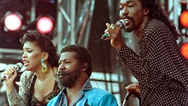 In a July 13, 1985 file photo singers from left, Valerie Simpson, Teddy Pendergrass and Nicholas Ashford perform at JFK Stadium in Philadelphia Pa. (AP Photo/ Amy Sancetta)
