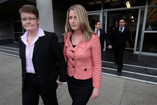 Same-sex couples from left, Kris Perry, Sandy Stier, Jeffrey Zarrillo and Paul Katami leave the federal courthouse after their first day in court in San Francisco, Monday, Jan. 11, 2010. (AP Photo/Marcio Jose Sanchez)