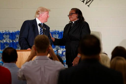 Rev. Faith Green Timmons interrupts Republican presidential candidate Donald Trump as he spoke during a visit to Bethel United Methodist Church, Wednesday, Sept. 14, 2016, in Flint, Mich. Timmons asked that Trump not deliver a political speech, and keep h