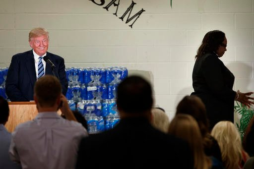 Rev. Faith Green Timmons, right, walks offstage after interrupting Republican presidential candidate Donald Trump as he spoke during a visit to Bethel United Methodist Church, Wednesday, Sept. 14, 2016, in Flint, Mich. Timmons asked that Trump not deliver