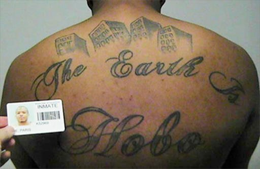 "This undated photo in a court filing provided by the United States Attorney's office in Chicago, shows Paris Poe's back tattoo that reads ""The Earth Is Our Turf"", and Hobo. Poe is one of six defendants on trial for racketeering and other charges are purpo"