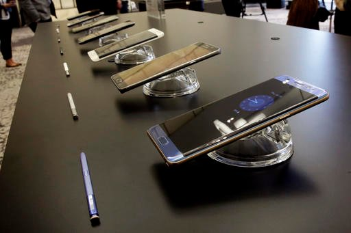 The Galaxy Note 7, foreground, is displayed in New York.