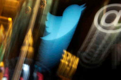 In this Wednesday Nov. 6, 2013, file photo, the Twitter logo appears on an updated phone post on the floor of the New York Stock Exchange. A new Twitter app is coming to Xbox One, Apple TV and Amazon Fire TV, where viewers will be able to watch the NFL's
