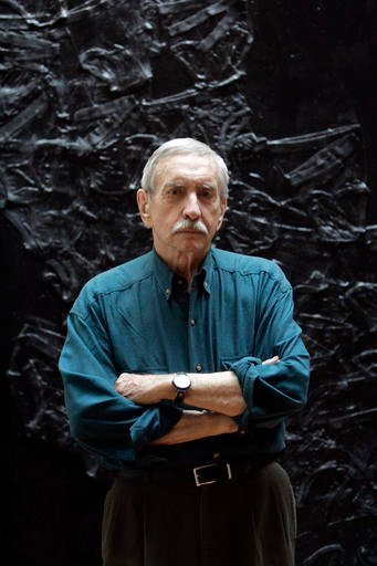 In this March 13, 2008, file photo, Edward Albee poses for a portrait in New York. The three-time Pulitzer Prize-winning playwright has died in suburban New York City at age 88.