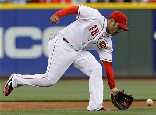 FILE - In this May 9, 2009, file photo, Cincinnati Reds shortstop Jerry Hairston Jr. fields a ground ball hit by a St. Louis Cardinals batter ina baseball game in Cincinnati.