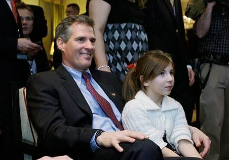 Massachusetts State Sen. Scott Brown, R-Wrentham, watches election night returns with family and supporters in his room in Boston, Tuesday, Jan. 19, 2010.
