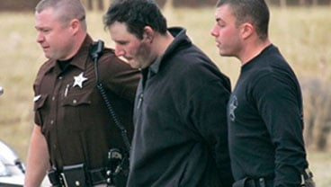 Murder suspect Christopher Speight, center, is led out of State Police headquarters in Appomattox, Va., Wednesday, Jan. 20, 2010. Speight is accused of killing eight people and leading police on an overnight manhunt. (AP Photo/Steve Helber)