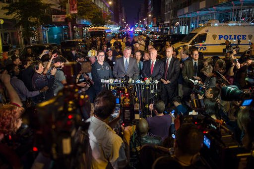 Mayor Bill de Blasio, center, and NYPD Chief of Department James O'Neill, center right, speak during a press conference near the scene of an apparent explosion on West 23rd street in Manhattan's Chelsea neighborhood, in New York, Saturday, Sept. 17, 2016.