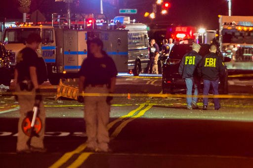 Members of the Federal Bureau of Investigation (FBI) carry on the investigations in the scene of an explosion on West 23rd Street and 6th Avenue in Manhattan's Chelsea neighborhood in New York, early Sunday, Sept. 18, 2016.  (AP Photo/Andres Kudacki)
