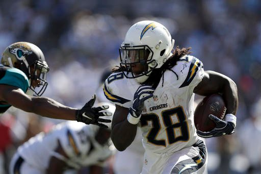 San Diego Chargers running back Melvin Gordon runs the ball during the second half of an NFL football game against the Jacksonville Jaguars, Sunday, Sept. 18, 2016, in San Diego. (AP Photo/Ryan Kang)