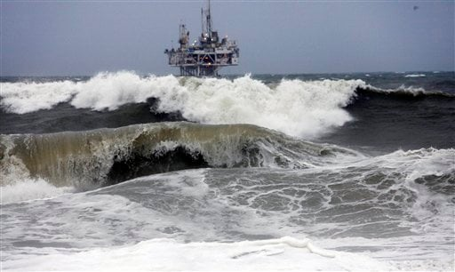 High-storm surf pounds the beach in front of an oil rig at Seal Beach, Calif., Wednesday , Jan 20, 2010.
