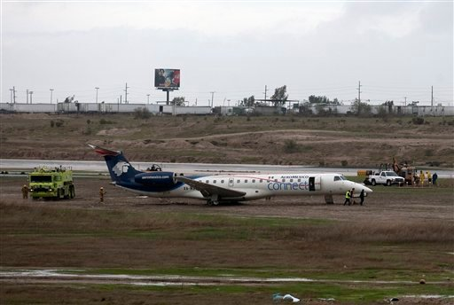 An Aeromexico aircraft is seen at the end of the runway at Tijuana's airport, Mexico, Thursday, Jan. 21, 2010.
