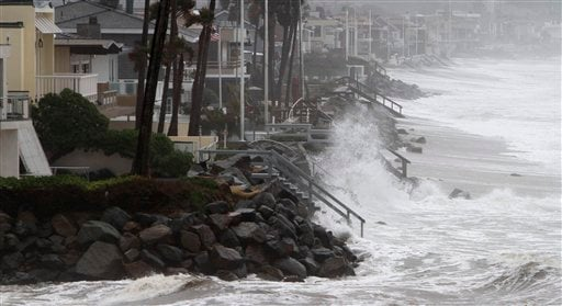 The Pacific ocean pounds the coast line fronting million dollar homes in Del Mar, Calif. Thursday Jan. 21, 2010 as storms continue to bring heavy rain, high surf, and high winds. (AP Photo/Lenny Ignelzi)
