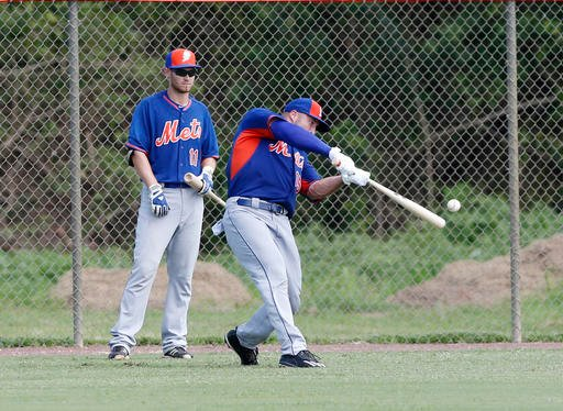 Tim Tebow, right, bats as Patrick Mazeika (11) waits his turn at the New York Mets' complex, Monday, Sept. 19, 2016, in Port St. Lucie, Fla.