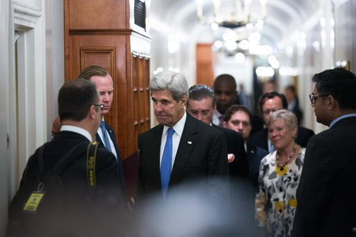 U.S. Secretary of State John Kerry arrives to greet Prime Minister Nawaz Sharif of Pakistan during a bilateral meeting Monday, Sept. 19, 2016, in New York . (AP Photo/Kevin Hagen)