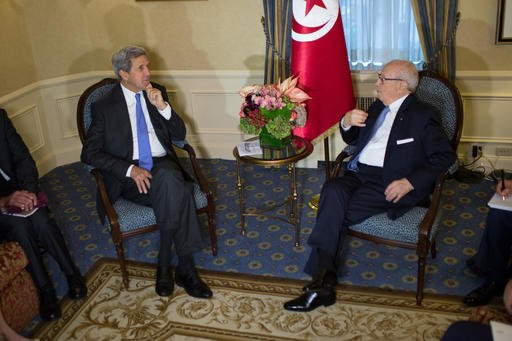 U.S. Secretary of State John Kerry sits with President Beji Caid Essebsi of Tunisia during a bilateral meeting Monday, Sept. 19, 2016, in New York . (AP Photo/Kevin Hagen)