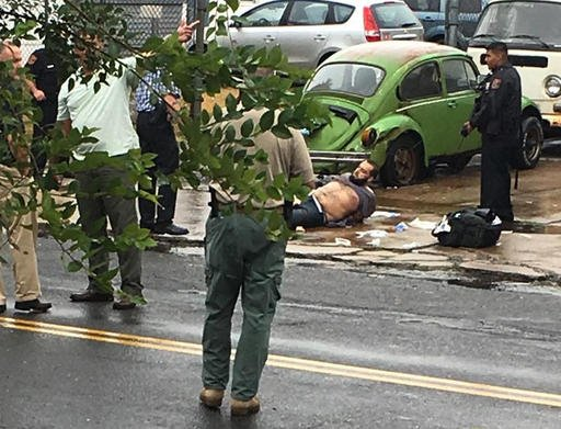 Ahmad Khan Rahami is taken into custody after a shootout with police Monday.