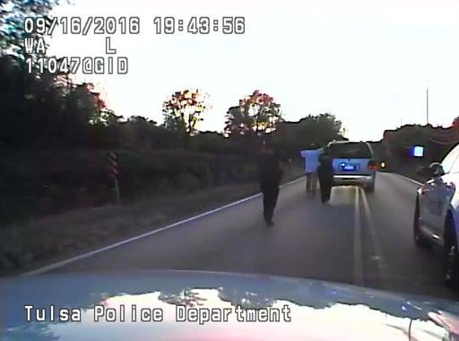 In this image made from a Friday, Sept. 16, 2016 police video, Terence Crutcher, center, is pursued by police officers as he walk to an SUV in Tulsa, Okla. Crutcher was taken to the hospital where he was pronounced dead after he was shot by the officer ar