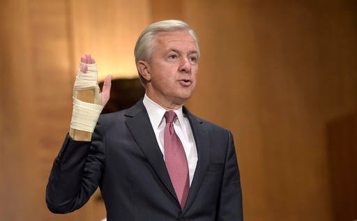 "Wells Fargo Chief Executive Officer John Stumpf is sworn in on Capitol Hill in Washington, Tuesday, Sept. 20, 2016, prior to testifying before Senate Banking Committee. Strumpf said he's committed to addressing ""unethical sales practices"" at the bank as h"