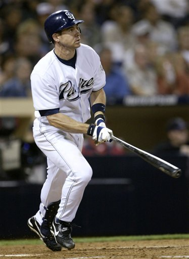 In this Sept. 3, 2004, file photo, San Diego Padres' Mark Loretta watches his double against the Colorado Rockies in a baseball game in San Diego.