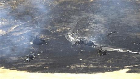 The plane had just taken off on a training mission from nearby Beale Air Force Base. The two pilots ejected before the crash. (AP Photo/Rich Pedroncelli)