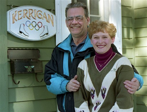 FILE - This Feb. 10, 1994 file photo shows Daniel and Brenda Kerrigan, the parents of Nancy Kerrigan, a silver medalist in figure skating at the 1994 Olympics, outside their home in Stoneham, Mass.