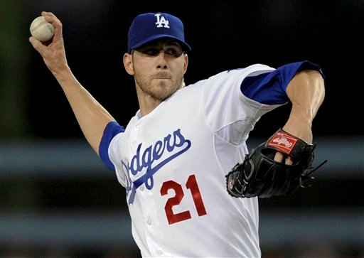 Los Angeles Dodgers' Jon Garland pitches during the first inning of a baseball game against the Arizona Diamondbacks, Thursday, Sept. 3, 2009, in Los Angeles. (AP Photo/Gus Ruelas)
