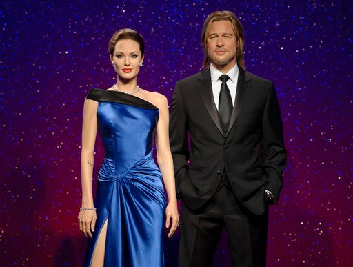 This 2013 photo released by Madame Tussauds shows wax figures resembling married actors Angelina Jolie Pitt, left, and Brad Pitt on display at a Madame Tussauds wax museum.