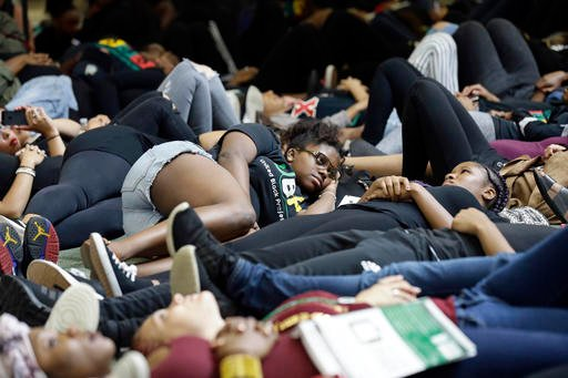Students at the University of North Carolina Charlotte hold a vigil by lying on the floor of the student union following Tuesday's fatal police shooting of Keith Lamont Scott at The Village at College Downs apartment complex in Charlotte, N.C., Wednesday,
