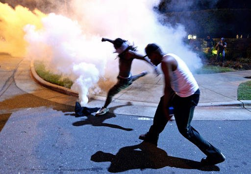 Protesters demonstrate in Charlotte, N.C., Tuesday, Sept. 20, 2016. Authorities used tear gas to disperse protesters in an overnight demonstration that broke out Tuesday after Keith Lamont Scott was fatally shot by an officer at an apartment complex. (Jef