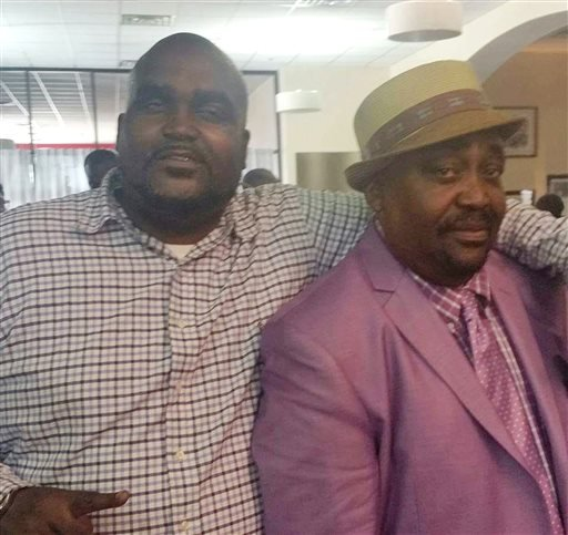 This undated photo provided by the Parks & Crump, LLC shows Terence Crutcher, left, with his father, Joey Crutcher. Crutcher, an unarmed black man was killed by a white Oklahoma officer Friday, Sept. 16, 2016, who was responding to a stalled vehicle. (Cou
