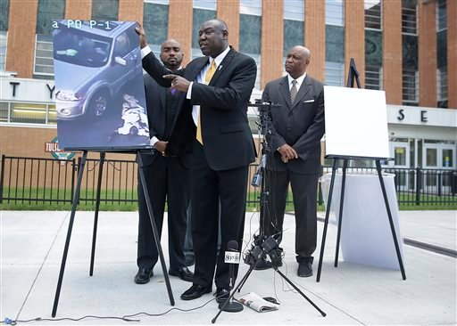 Attorney Benjamin Crump, center, one of the attorneys for Crutcher's family, speaks about Terence Crutcher during a news conference about the shooting death of Crutcher Tuesday, Sept. 20, 2016 in Tulsa, Okla. Crutcher, was shot by a Tulsa Police officer o