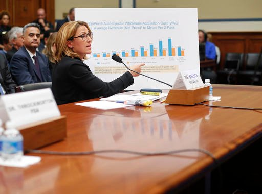 Mylan CEO Heather Bresch points to her chart to help her answer questions while testifying on Capitol Hill in Washington, Wednesday, Sept. 21, 2016, before the House Oversight Committee hearing on EpiPen price increases. Bresch defended the cost for life-