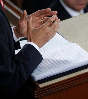 President Barack Obama gestures as he delivers his State of the Union address on Capitol Hill in Washington, Wednesday, Jan. 27, 2010.