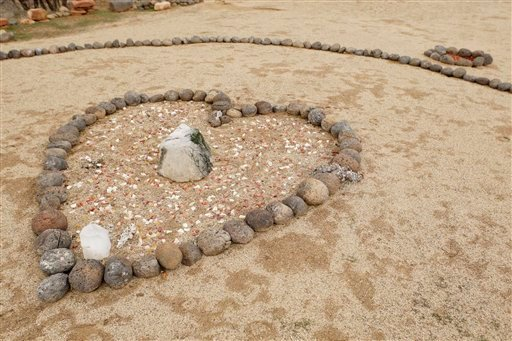 A heart-shaped memorial marks the site where three people died during a sweat lodge ceremony in October. (AP Photo/Ross D. Franklin)