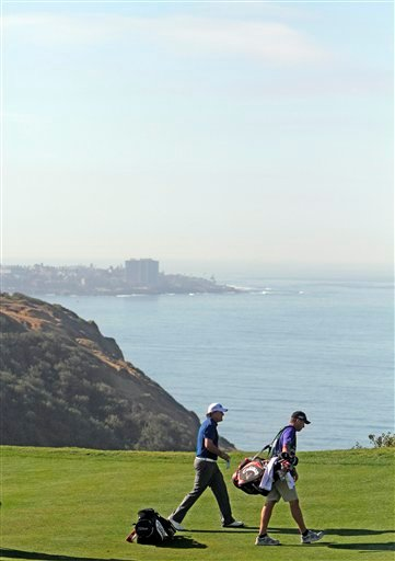 "Phil Mickelson and caddie Jim ""Bones"" McKay walk off the third green with the La Jolla cove as a back drop during the opening round of the Farmers Insurance Open golf tournament at Torrey Pines Golf Course Thursday Jan. 28, 2010 in San Diego."