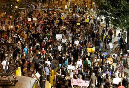 Demonstrators protest Tuesday's fatal police shooting of Keith Lamont Scott in Charlotte, N.C.