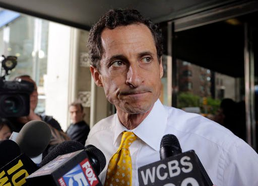 In this July 24, 2013 file photo, New York City mayoral candidate Anthony Weiner leaves his apartment building in New York. Disgraced former congressman Anthony Weiner has acknowledged he communicated online with a girl who accused him of sending sexuall