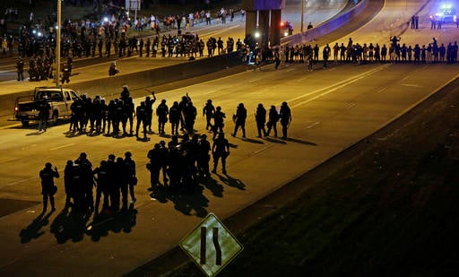 Police confront protesters blocking I-277 during demonstrations following Tuesday's police shooting of Keith Lamont Scott in Charlotte, N.C.