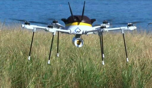 A test drone making a UPS delivery lands on Children's Island in Marblehead, Mass.