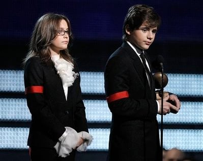Michael Jackson's children Paris, left, and Prince Michael Jackson II accept the Lifetime Achievement award on behalf of their father at the Grammy Awards.