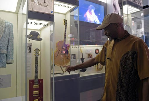 Ellis McDaniel, Jr., son of Bo Diddley, stops to look at the exhibited space dedicated to his father at the National Museum of African American History and Culture.