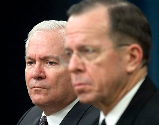 Defense Secretary Robert Gates, left, and Joint Chiefs Chairman Adm. Mike Mullen hold a briefing at the Pentagon, Monday, Feb. 1, 2010. (AP Photo/Kevin Wolf)