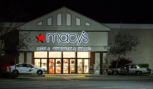 Law enforcement investigate a deadly shooting in the Macy's store at the Cascade Mall in Burlington, Wash.